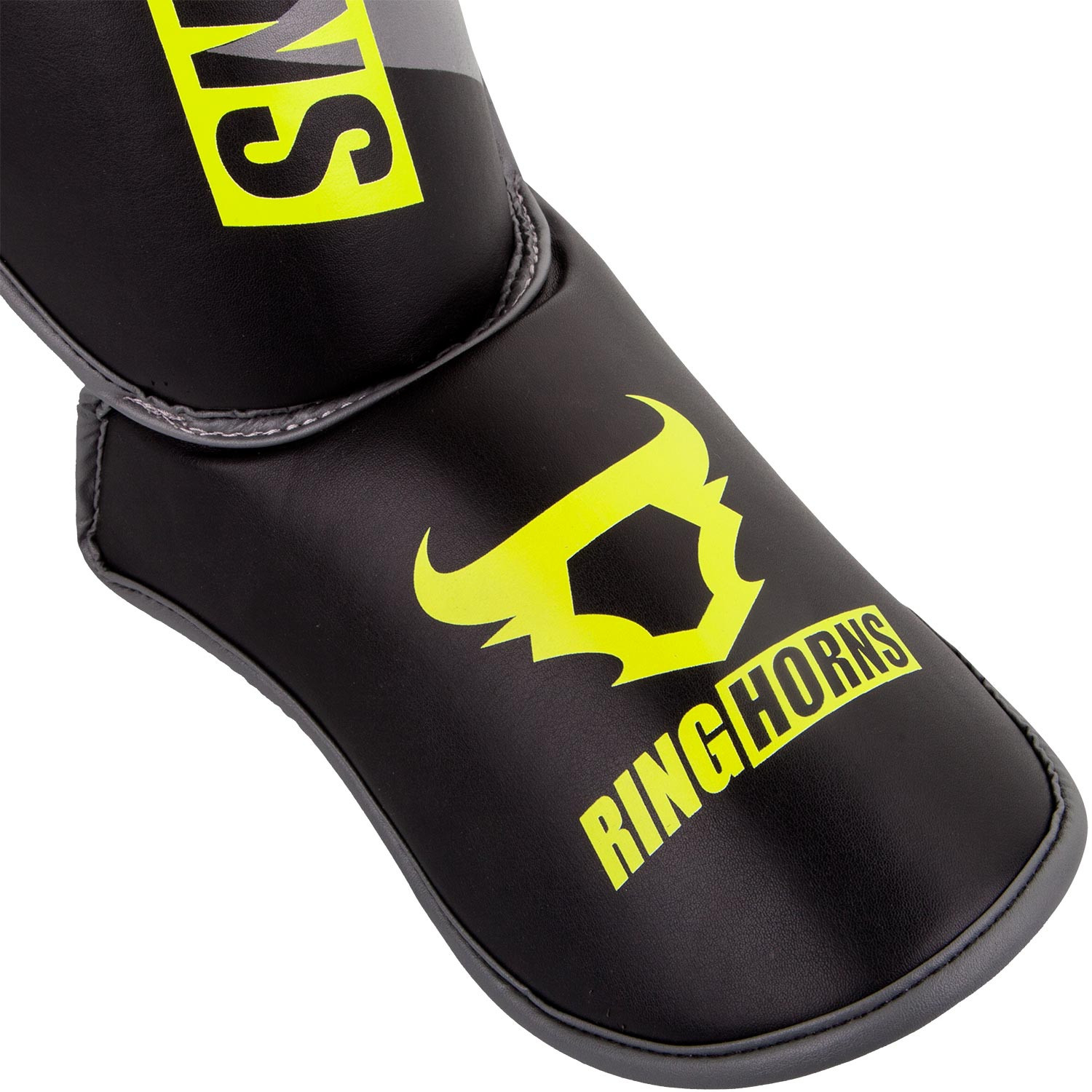 shinguards_insteps_charger_black_neoyellow_1500_03_1